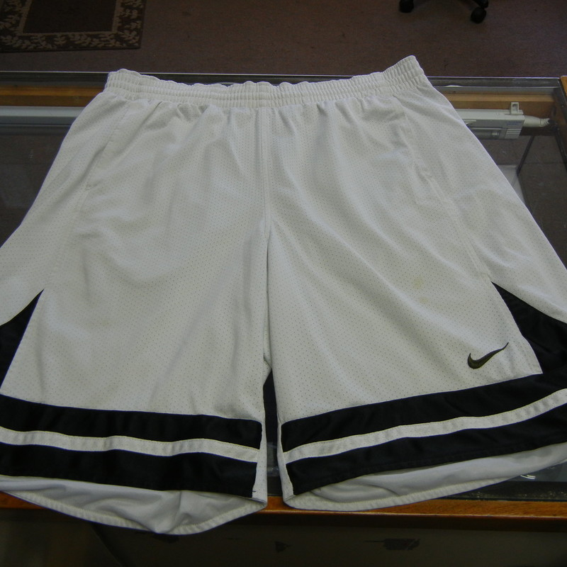 "Nike Men's Basketball Mesh with lining Shorts Size XL White Polyester #9942<br /> Rating:   (see below) 3 - Good Condition<br /> Team: n/a<br /> Player: N/A<br /> Brand: Nike<br /> Size: XL - Men's(waist 34""; Length 23""; Inseam 10"") <br /> measurements are from armpit to armpit and from shoulder to hem; - please check measurements. <br /> Color: White<br /> Style: Basketball Shorts; Embroidered logo; Elastic waist; Drawstring; Mesh with lining<br /> Material: 100 Polyester<br /> Condition: - Good Condition - wrinkled; Snags throughout the front and the back; Material is discolored; Stains on the right leg above the logo; Light stain on the front of the right leg; Definite signs of use(See Photos for condition and description)<br /> Shipping: $4.34<br /> Item #: 9942"