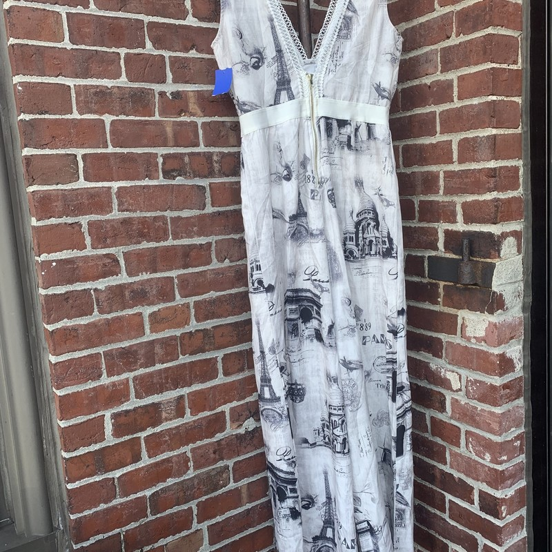 Fun, printed jumpsuit from La Reyna with images of architecture from Paris. Features a deep v-neck and gold zip along the back. Size large.
