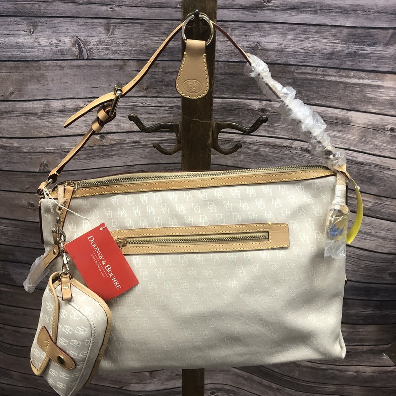 New with tags Dooney & Bourke purse as is.  NOW ON SALE 20% off the orginal price.  This great bag comes with a wristlet and a key fob!  It is marked as is because there is some discoloration on the leather.  Perfect for all seasons!!