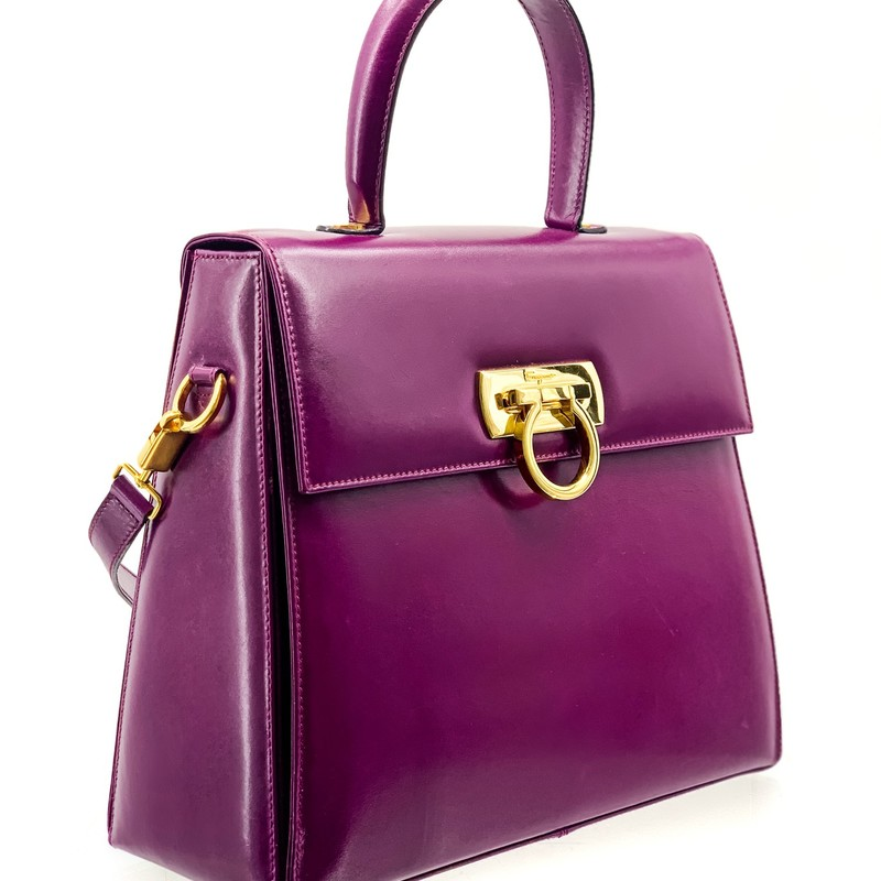 Salvatore Ferragamo wine colored leather lady bag, excellent condition.<br /> <br /> has long strap