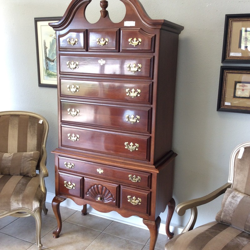 "And high it is at 80""!  This high boy by Dixie is your quintessential representation of this period piece. Classic lines and design are it's signature, it features a rich, dark wood finish and shiny brass hardware. But, it's not just pretty - it features alot of storage space with 11 drawers. Great condition, come by and take a look!"