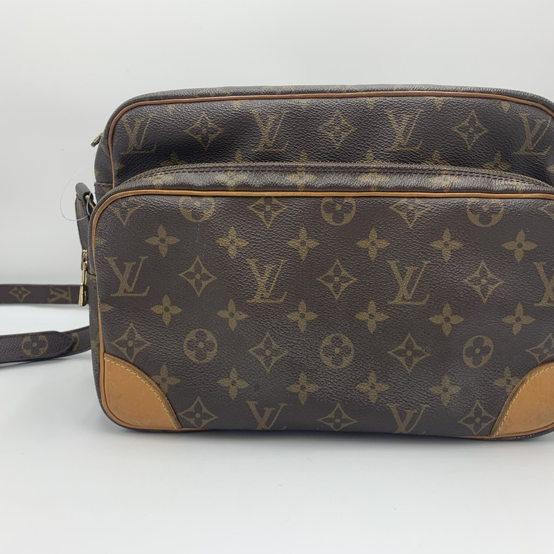 "LouisVuitton Monrgram Nil, Brown, Size: M<br /> <br /> condition: FAIR -- tarnishing on hardware, some discoloration on leather and strap<br /> <br /> Shoulder Strap Drop: 20""<br /> Height: 8""<br /> Width: 13""<br /> Depth: 3.25""<br /> <br /> We guarantee the authenticity of every bag on our site. Each bag comes with either an original sales receipt or a Certificate of Authenticity from AuthenticateFirst.com. Established in 2013, AuthenticateFirst.com<br /> (http://authenticatefirst.com) is one of the premier authentication services in the US, providing authentications of designer handbags, wallets, small leather goods, footwear, jewelry, and accessories. They employee in-house experts who have decades of experience working with hundreds of luxury brands."
