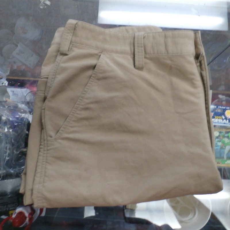 "Under Armour Men's Shorts Size 34 Tan Nylon blend #34740<br /> Rating:   (see below) 4- Fair Condition<br /> Team: N/A<br /> Player: N/A<br /> Brand: Under Armour<br /> Size: Men's   34 (Measured Flat: across waist 17"", length 21"" Inseam 11"" )<br /> Measured flat: hip to hip; hip to hem; and groin to hem<br /> Color: Tan<br /> Style: Men's Shorts button close with zipper has pockets; embroidered logo;<br /> Material: 56% Nylon 40 polyester 4% spandex<br /> Condition: - 4- Fair Condition - wrinkled; item has some very light staining throughout from use;<br /> Item #: 34740<br /> Shipping: FREE"