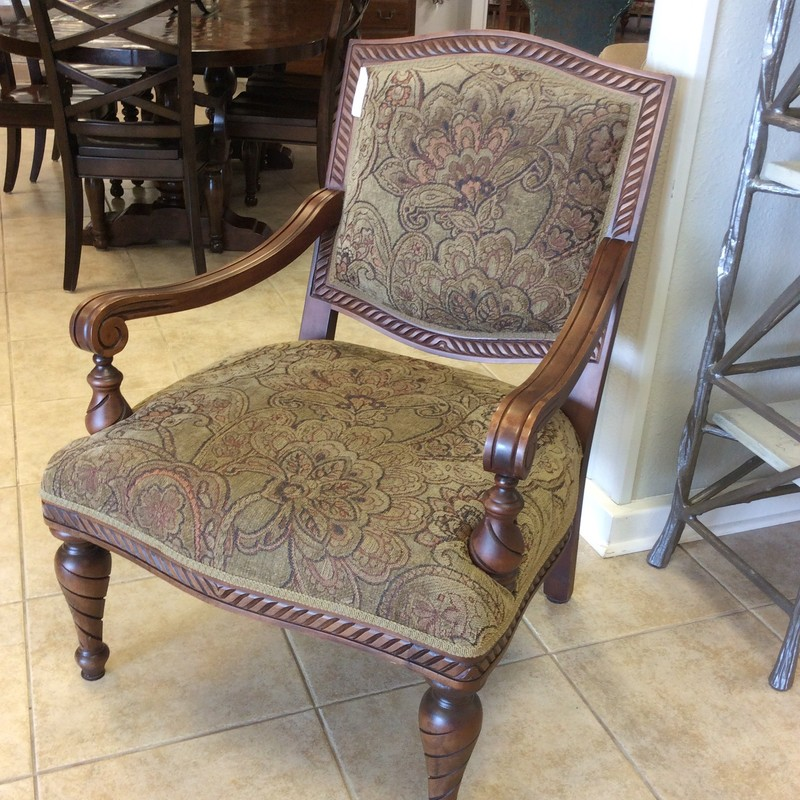 This chair features a leafy,  floral pattern in the softest  of greens and rust. The picture really doesn't do the colors justice so you need to come by and take a look. The frame has a dark finish and detailed woodwork. Very nice!