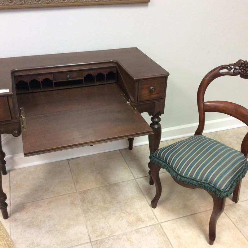 SO SWEET!! This adorable ANTIQUE duo is in great condition. Both pieces feature solid wood construction with a mahogany finish. The chair has pretty carved details, and the desk has 3 drawers and 7 small cubbies.