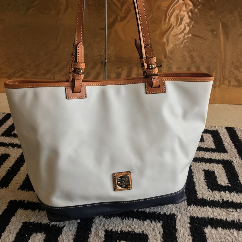 Gorgeous Dooney & Bourke Tote Bag! White and navy leather with brown leather trim and gold hardware. Barely been used, no signs of use. Retail: $268. WON'T LAST LONG!