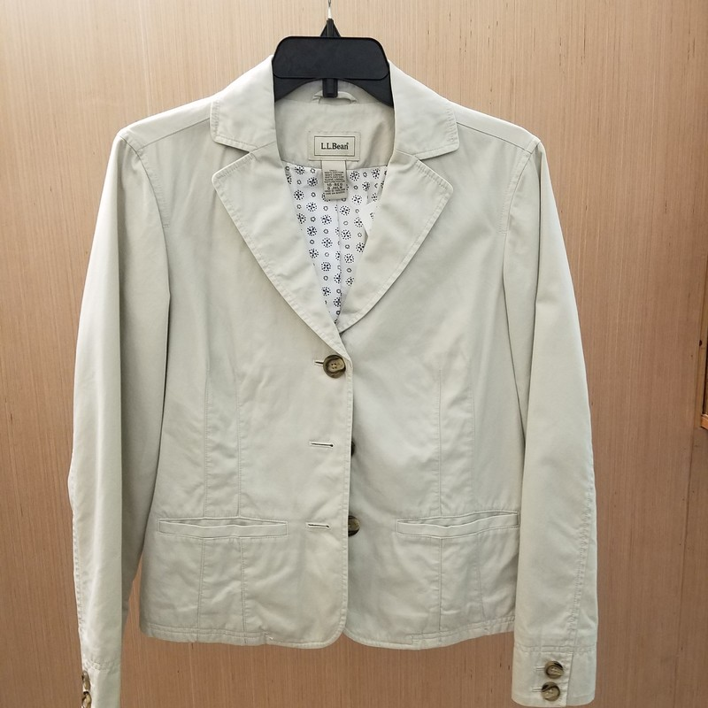 Beautiful. Cream 100% Cotton blazer.<br /> With 3 button front closure, 2 button detail at wrists and flat front pockets this jacket can easily be dressed up or down..