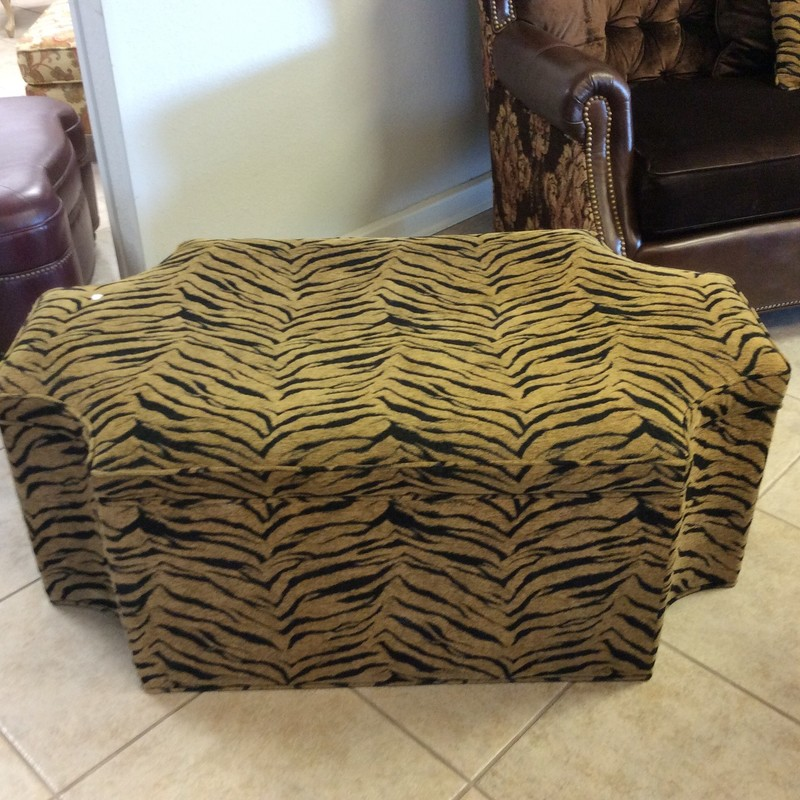 This ottoman has a rather an unusual octagonal shape. It is upholstered in a tiger striped, cut chenille fabric that is in fabulous condition.