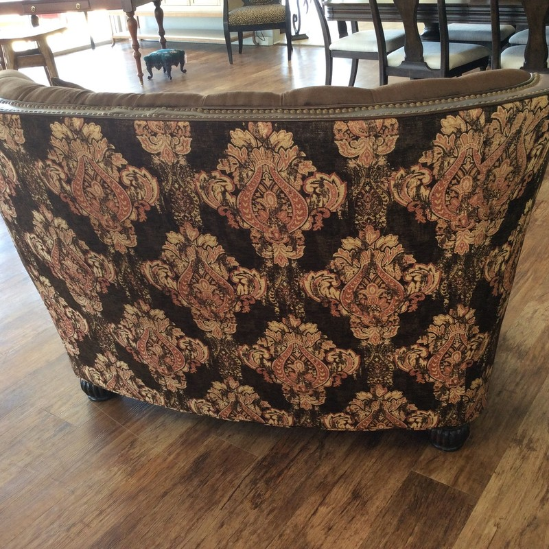 THIS IS GORGEOUS! By Massoud, It features a solid wood frame, leather arms and accents, rich brown velveteen upholstery, and a coordination brocade print back. To top that all off, it has handsome nailhead accents, as well.