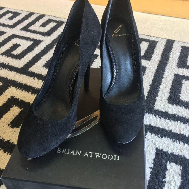 GORGEOUS Brian Atwood Heel. Black suede with sparke underneath. Only been worn maybe 10 times. No signs of use, except for the underneath where the leather sole has been worn (shown in photos). Approx: 4.5 inch heel. Retail price: $328. Size 8.5. Includes box and individual duster bags. Don't miss out on these GORGEOUS heels!