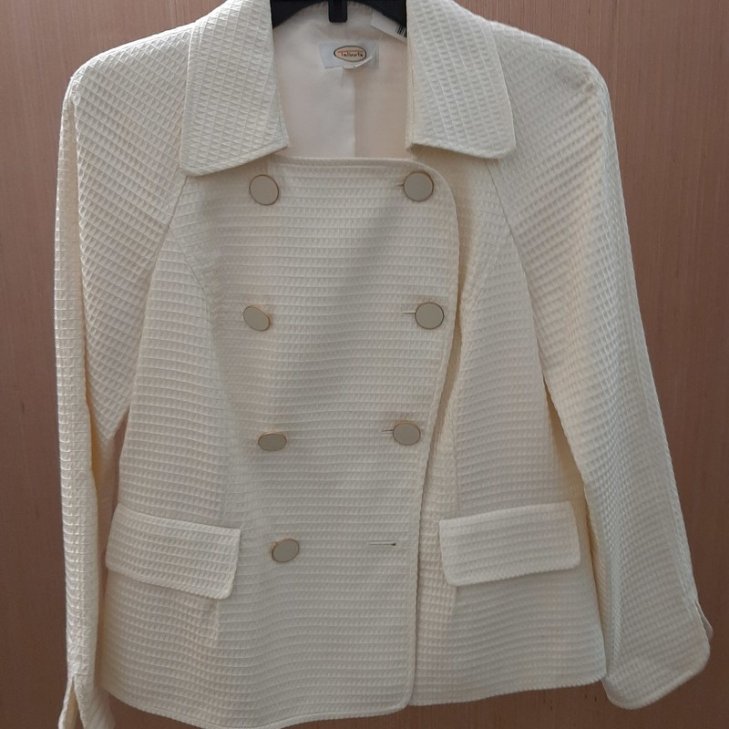 Cotton waffle weave, double breasted jacket with enamel buttons. Great for dress up or casual. This jacket is gorgeous.