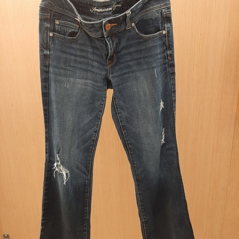 American Eagle distressed slim boot cut jeans size 12. In excellent condition. Distressing detail throughout front and some on the back pocket. Stretch material