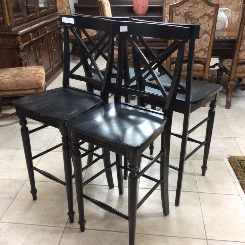 This is a great set of barstools! They have been painted black with a touch of distressing in brown for added character. They're in near-perfect condition and would work with many different decorative styles. Come take a look while they're here!