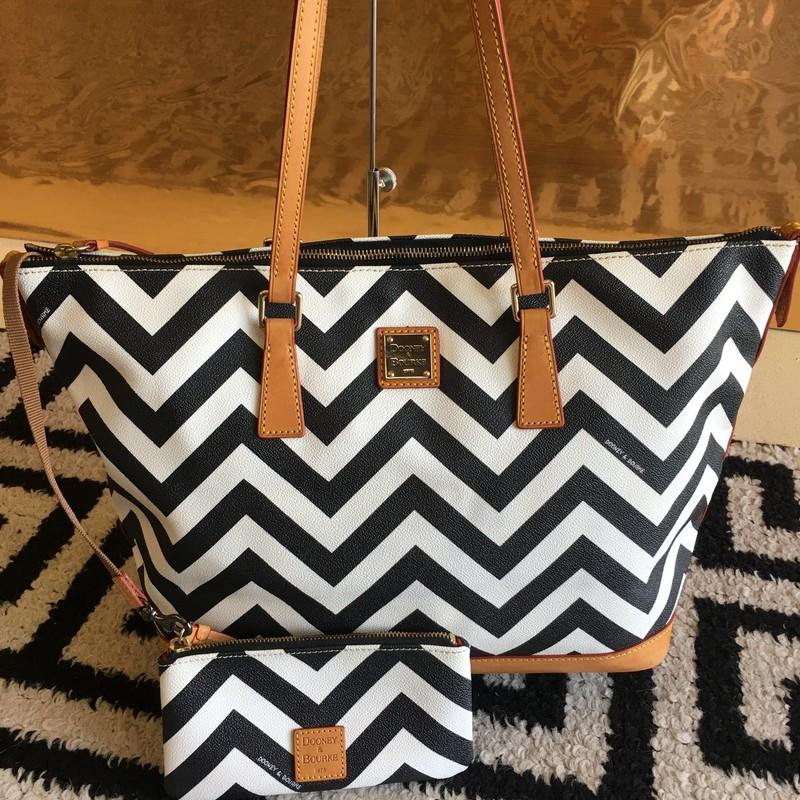 GENTLY USED Dooney & Bourke chevron tote bag. Black and white leather with brown detail, red interior and gold hardware. Includes matching change purse. Zip top. Few signs of use in cloth interior (shown in photos). No signs of use on exterior. WON'T LAST LONG! Super trendy!