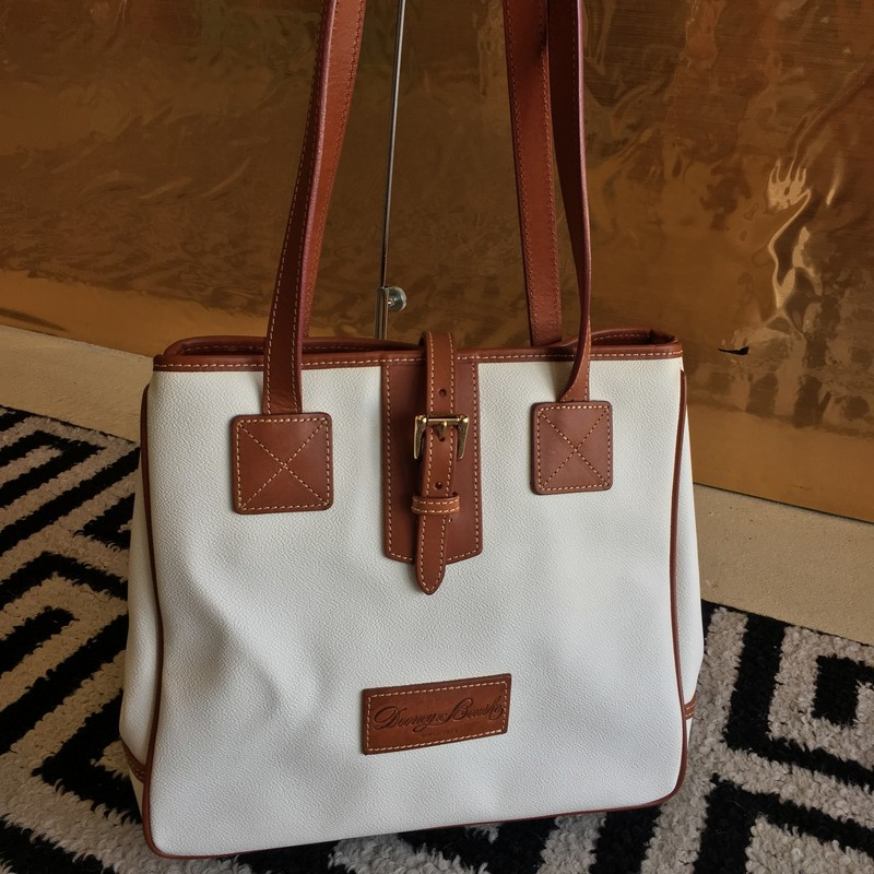 LIKE NEW Dooney & Bourke shoulder bag. White leather with brown trim and red interior and gold hardware. Expandable sides. ZERO signs of use, no scuffs or markings interior or exterior.  WON'T LAST LONG!