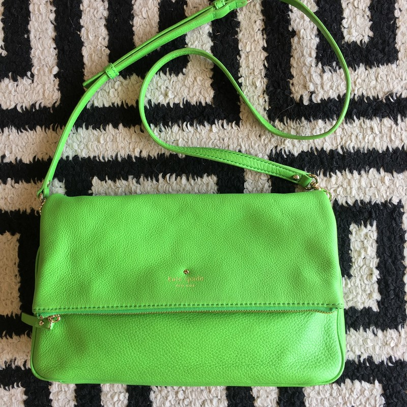 LIKE NEW Kate Spade folded crossbody. Lime green leather with gold hardware. Removable/adjustable strap. No signs of use on the interior. One very small scuff on exterior (shown in photos). Retail: $258. Ready to go to a new home!