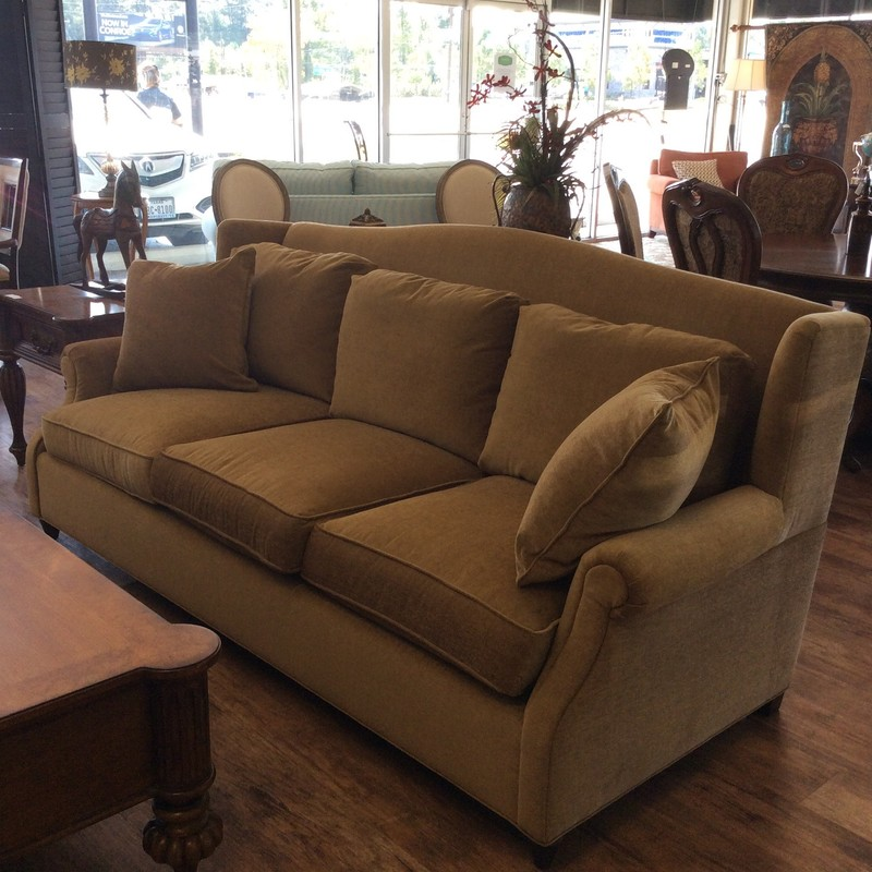 "This sofa by Norwalk Furniture is so nice and it is in pristeen condition. Don't know that it's even been sat on! Large at 86"" long and deep, it's very comfortable and plush. Upholstered in a soft gold cotton blend, it has a camelback and small rolled arms. Pillows are detatched. Come by and take a look!"