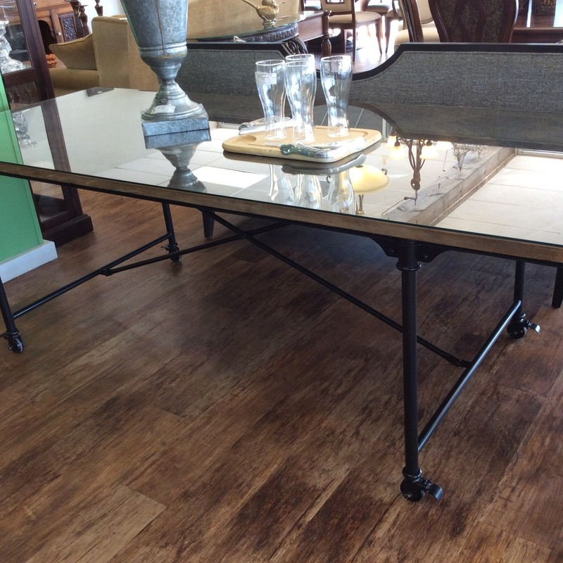 This RESTORATION HARDWARE dining room table would be perfect for your next holiday gathering! It features heavy iron base/legs, and the feet all have lockable wheels. The table top is constructed of what appears to be reclaimed wood, pieced together in a diamond design. There is a glass topper, as well.