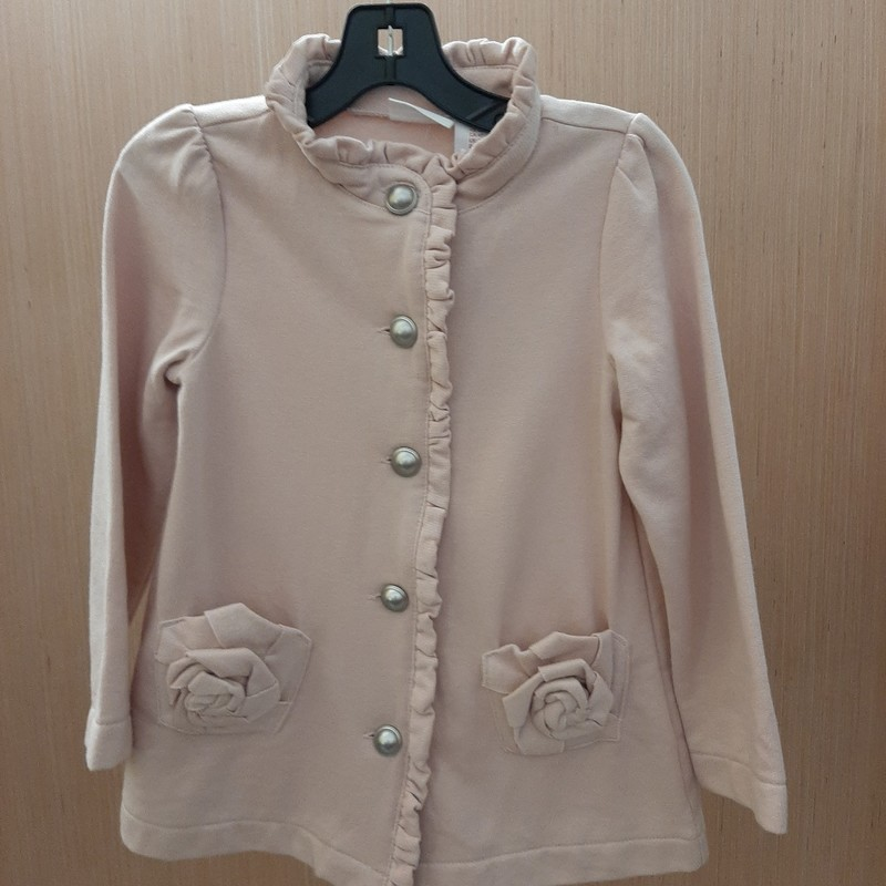 Jacket is a gorgeous super soft cotton blend with ruffle down front and at neck. Front pockets have a rosette design.<br /> <br /> Perfect for every day use or for a formal occasion.