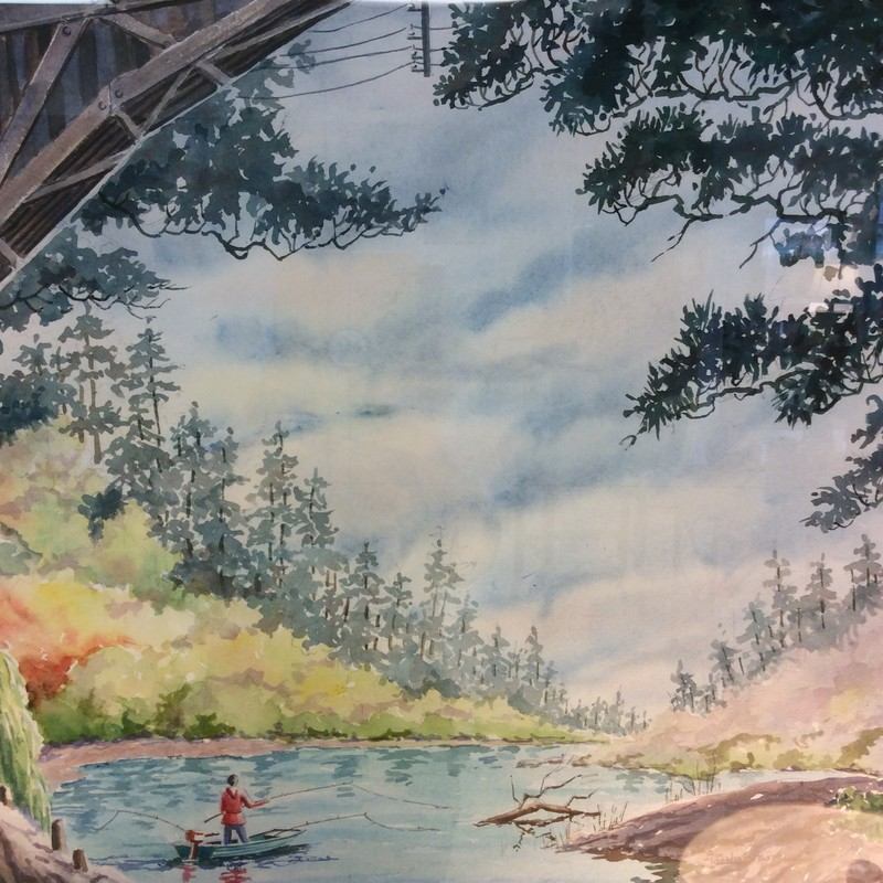 This is a very nice watercolor. Looks like spring, but it's hard to tell. The colors are light and muted. The scene depicts a lone fisherman on a riverbend beneath an old, arched bridge and a canopy of tree tops. The matting is neutral, the frame simple and refined.