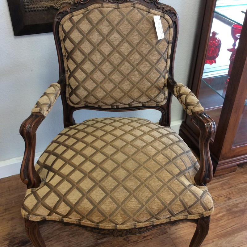 This sure is an elegant looking arm chair. It was made in ITALY and features solid wood construction with a dark walnut finish and exquisite carved details. The diamond patterned upholstery is in excellent condition. This chair is very comfortable, too!