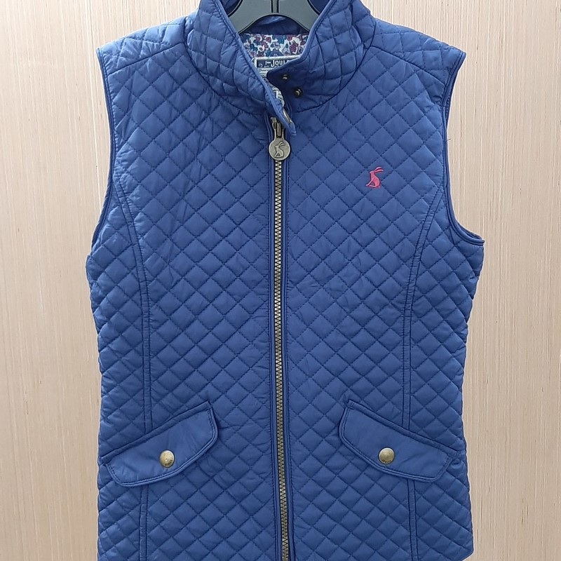 This sweet and cozy blue puffer vest by Joules features 2 large front pockets with snaps and snap closure. Cute rabbit details. Perfect for Fall.