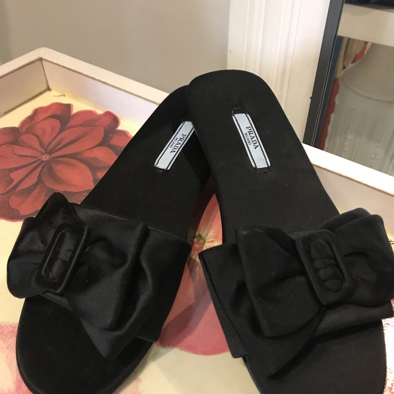 Prada, Black satin slides with a buckled bow on top Size: 37/6.5