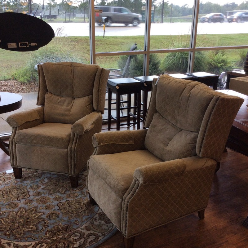 This pair is modern and luxurious! We get so many great recliners in here but this pair is unique! They're by Norwalk Furniture. Norwalk specializes in custom furniture of superior quality and value. The upholstery is a soft cotton blend in an attractive oyster color with a  light gold stitching that forms a subtle diamond pattern. Rather elegant. All finished off with a nailhead trim.