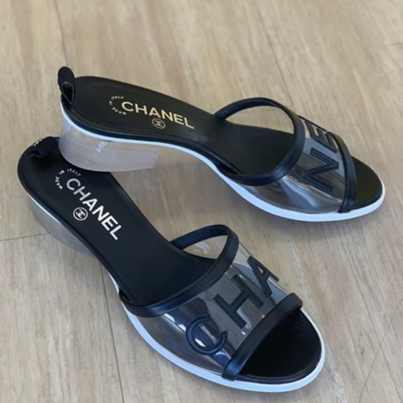 Chanel plexi and black slides with chunky lucite heel<br /> <br /> NEW STYLE SOLD OUT IN STORES
