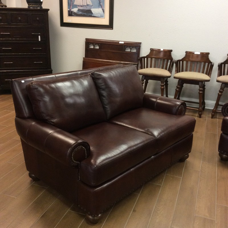 This loveseat is by Klaussner Home Furnishings and is from the Distinctions Collection.  It's upholstered in a rich, dark brown leather and features rolled arms and a nailhead trim. Good condition and has a matching sofa priced separately.