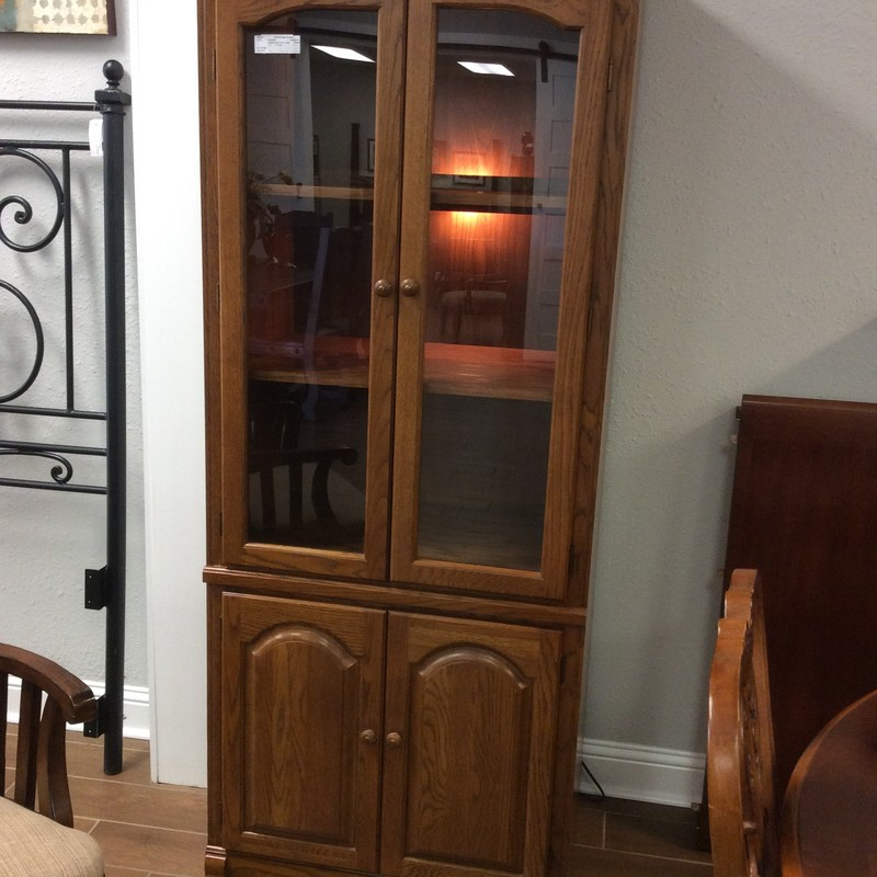 "This curio is quite the bargain at $175.00! Constructed of oak, it features adjustable shelving and interior lighting.The shelves are quite deep at 20"" and the cabinet is in good condition. It could also be used as a media cabinet or bookcase. Come by and take a look!"