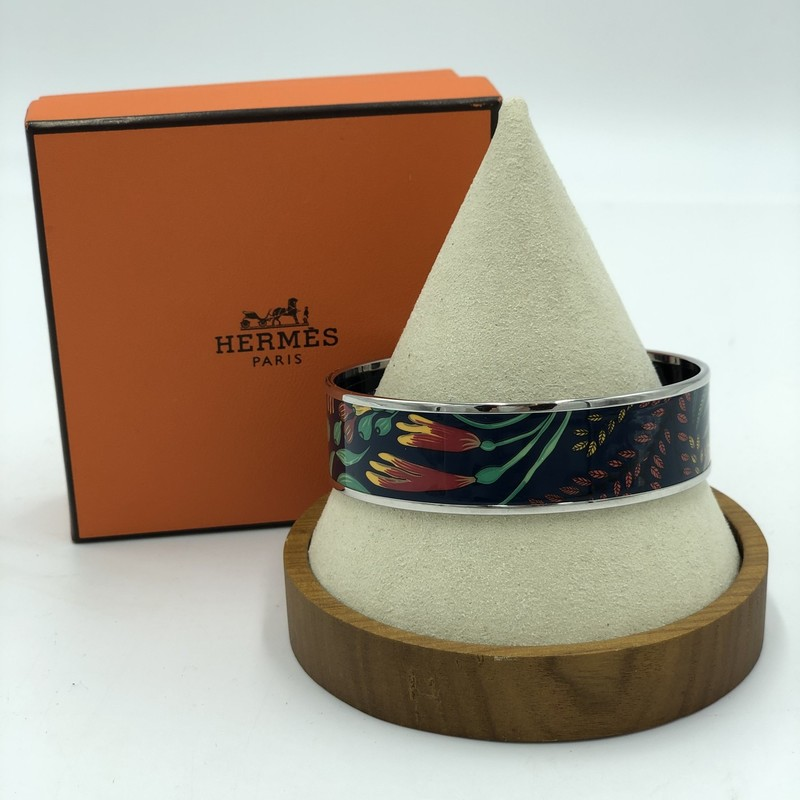 "Hermes Enamel Bangle, Multi, Size: NS<br /> <br /> ""La Marche de Savana Exotique""<br /> Estimated Retail: $570<br /> Box + dust bag included<br /> <br /> 9"" circumfrence<br /> .79"" wide"