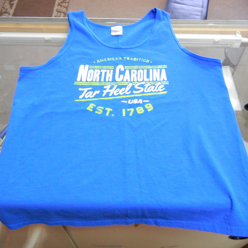North Carolina Tar Heels Men&#039;s Sleeveless Shirt Size Large Blue Cotton #10059<br /> Rating:   (see below) 3 - Good Condition<br /> Team: North Carolina Tar Heels<br /> Player: n/a<br /> Brand: Gildan<br /> Size: Large - Adult(Measured Flat: Across chest 20.5&quot;; Length 27&quot;) <br /> measurements are from armpit to armpit and from shoulder to hem; - please check measurements.  <br /> Color: Blue<br /> Style: Embroidered sleeveless shirt<br /> Material: 100 Cotton <br /> Condition: - Good Condition - wrinkled; Material looks and feels good; Minor pilling and fuzz; Material feels coarse; Small light stain on the right side of the front; No rips or holes(See Photos for condition and description)<br /> Shipping: $3.37<br /> Item #: 10059