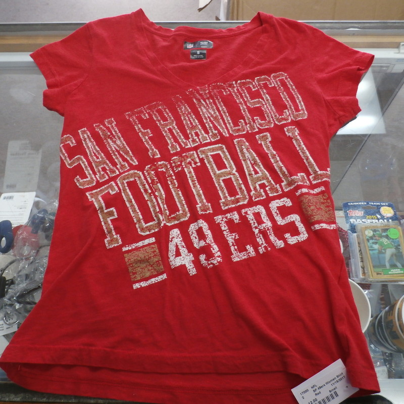 "San Francisco 49ers Women's Shirt Size Small Red #17000<br /> Rating:   (see below) 3- Good Condition<br /> Team:  San Francisco 49ers<br /> Player: Team<br /> Brand:  NFL Team Apparel<br /> Size: Women's small  (Measured Flat: across chest 16"", length 23"")<br /> Measured flat: armpit to armpit; top of shoulder to the bottom hem<br /> Color:  red<br /> Style:  short sleeve; v-neck  screen pressed shirt;<br /> Material:    100% cotton<br /> Condition: -3- Good Condition - wrinkled; minor pilling and fuzz;<br /> Item #: 17000<br /> Shipping: FREE"