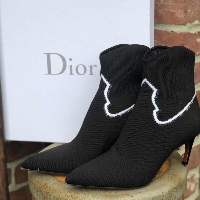 Christian Dior NIB $1090, Black, Size: 7.5<br /> Comfortable knit pointed toe boots worn only once. True to size 37.5, or 7.5. Includes dustbags, box and additional heel tack replacements!!