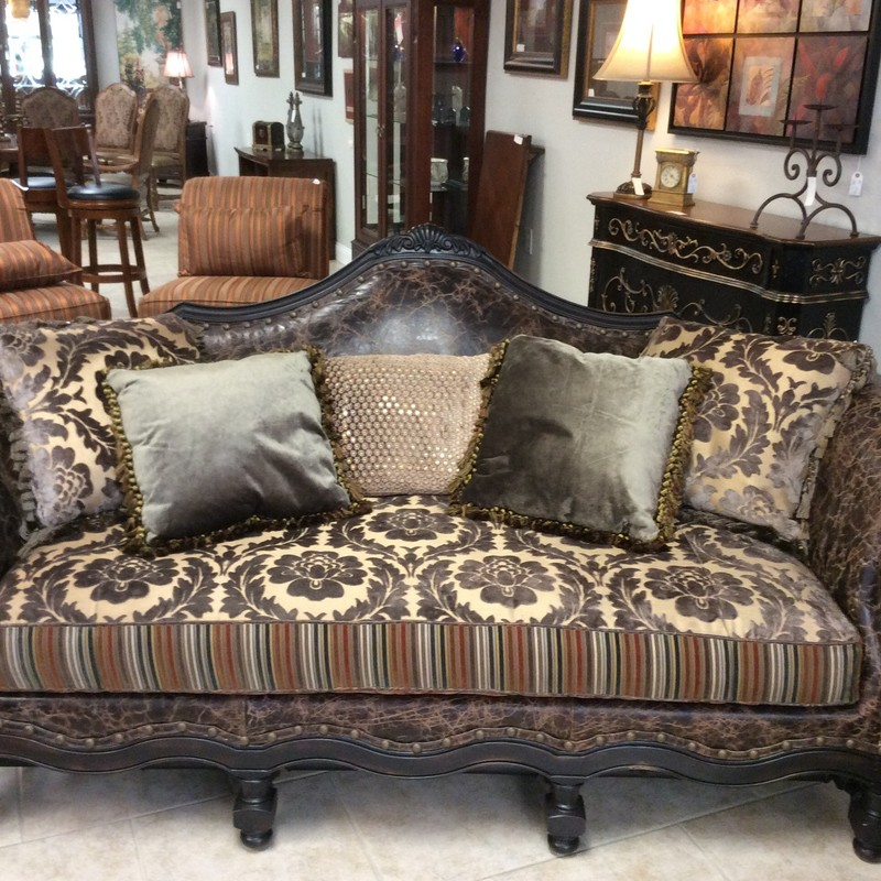 WOWIE ZOWIE! This is SOME duo, isn't it? These pieces feature a combination of rustic looking leather, a neutral taupe/tan floral brocade, a multi-colored, striped brocade and a bit of flashy sequined velvet upholstery. There are also lots of large handsome nailhead accents, and multiple throw pillows. Stop by and check this set out!