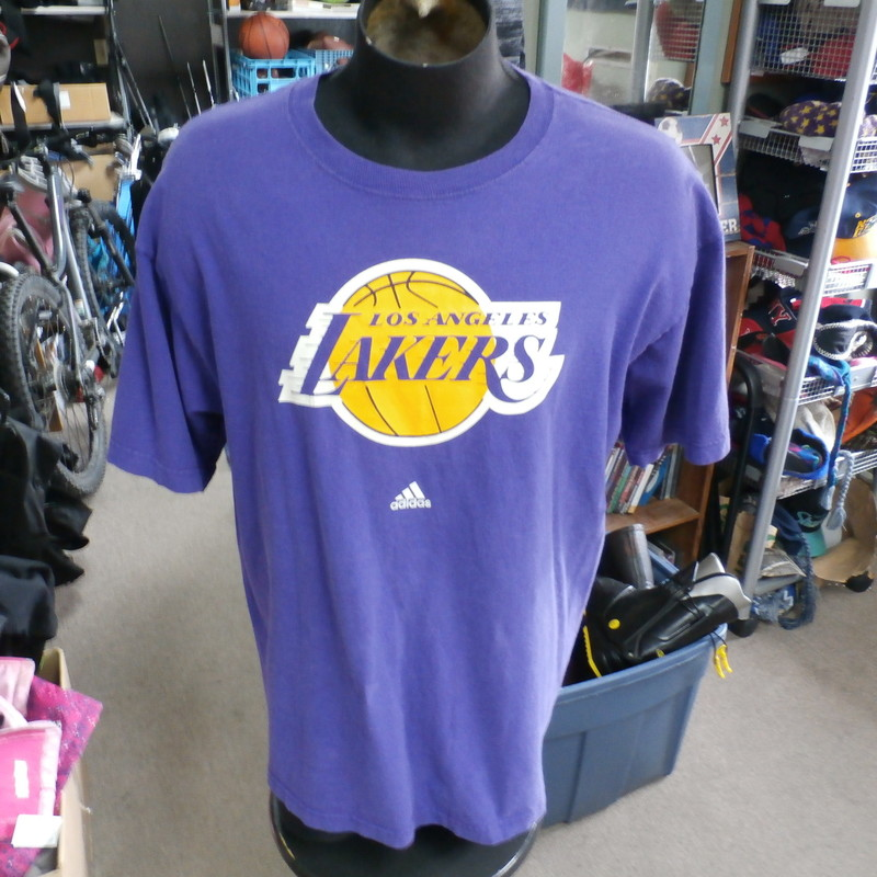 "Los Angeles Lakers purple Adidas shirt size XL 100% cotton #12362<br /> Rating: (see below) 3- Good Condition<br /> Team: L.A. Lakers<br /> Player: n/a<br /> Brand: Adidas<br /> Size: Men's XLarge- (Measured Flat: Across chest 24""; Length 29"")<br /> Measured Flat: underarm to underarm; top of shoulder to bottom hem<br /> Color: purple<br /> Style: short sleeve; screen printed<br /> Material: 100% cotton<br /> Condition: 3- Good Condition: minor wear from use and washing; faded material; cracks in screen printing (see photos)<br /> Item #: 12362<br /> Shipping: FREE"