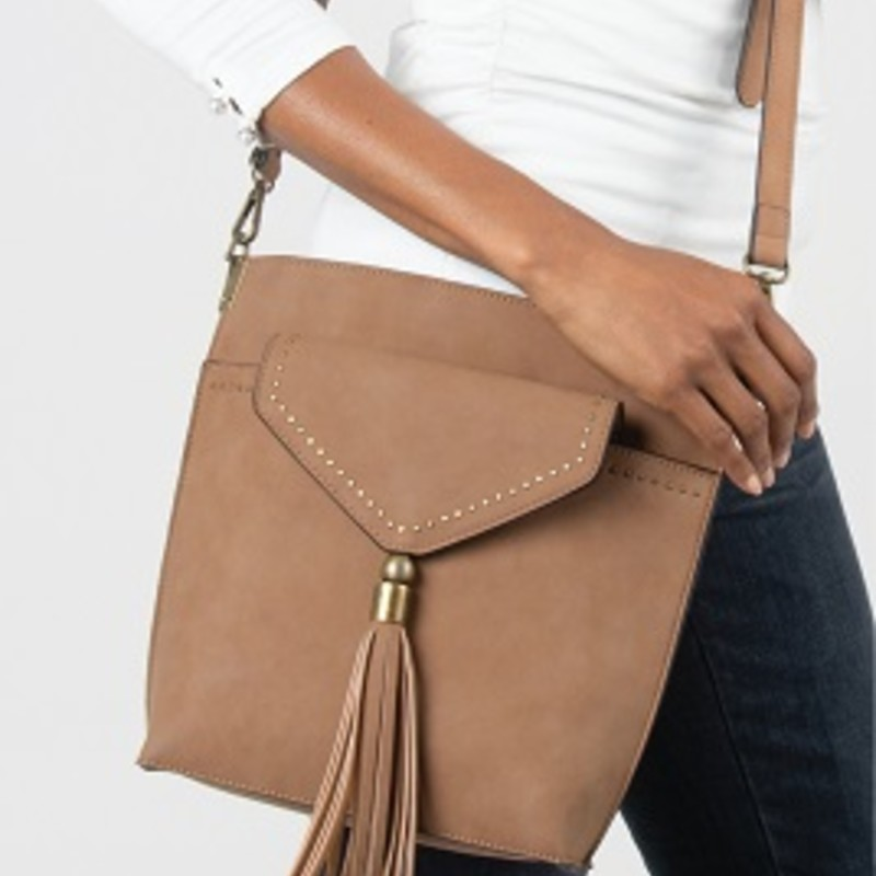 "Our Simply Noelle Purse is perfect for any occasion. Unique Textured Material with Small Stud Detail, Antiqued Gold and Silver Hardware, (Exterior)<br /> Adjustable/ Removable Crossbody Strap, Front Convenience Pocket with Removable Crossbody Bag Inside, Top Zipper Closure. 11""L x 3""W x 10.5""H. Crossbody: 7""L x .25""W x 7.5""H. Main-100% Polyurethane<br /> Lining- Polyester"