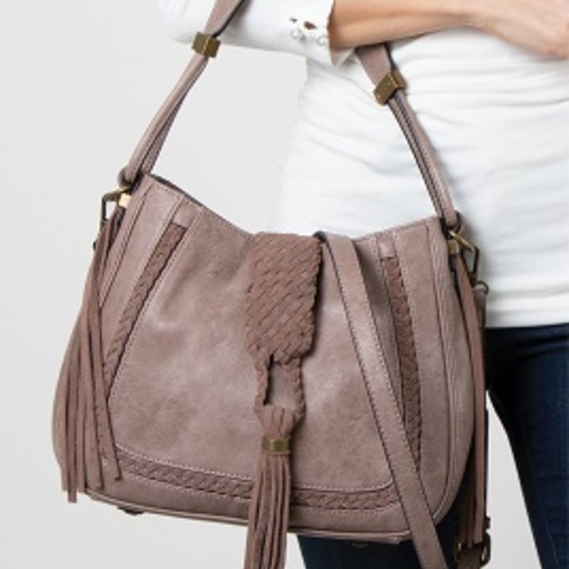 "Ladie our Simply Noelle Braided Satchel is perfect for any occasion. Distressed Material with Suede Tassel and Braid Details, Antiqued Gold Hardware, (Exterior) Adjustable/ Removable Crossbody Strap, Top Magnetic Closure, Back Zipper Pocket, Metal Feet, (Interior) Convenience Pockets, Zipper Pocket, Key Clip. 8.5""L x 3.75""W x 7""H. Shell- Polyurethane Lining- Polyester"