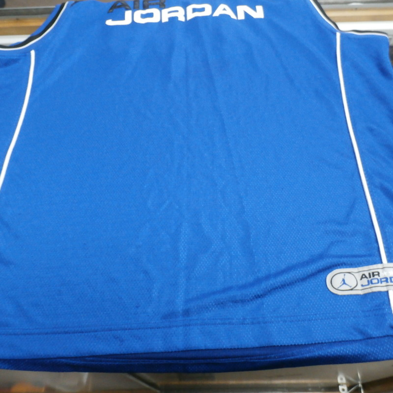 "Air Jordan Men's #23 Basketball Jersey Blue Size 2XL polyester #35155<br /> Rating:   (see below) 2- Great Condition<br /> Team:<br /> Player:  Michael Jordan<br /> Brand: Jordan<br /> Size: Men's 2XL  (Measured Flat: across chest 26"", length 32"")<br /> Measured flat: armpit to armpit; top of shoulder to the bottom hem<br /> Color: Blue<br /> Style: embroidered basketball Jersey;<br /> Material:    100% polyester<br /> Condition: - 2- Great Condition -<br /> Item #: 35155<br /> Shipping: FREE"
