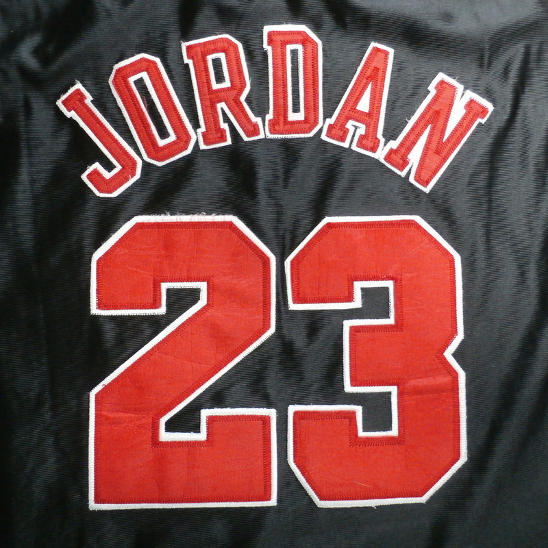 "Mitchell & Ness Men's Chicago Bulls #23 Michael Jordan Jersey Size XL #35152<br /> Rating:   (see below) 2- Great Condition<br /> Team: Chicago Bulls<br /> Player:   Michael Jordan<br /> Brand: Mitchell & Ness<br /> Size: Men's XL  (Measured Flat: across chest 24"", length 35"")<br /> Measured flat: armpit to armpit; top of shoulder to the bottom hem<br /> Color: black & Red<br /> Style: embroidered basketball Jersey;<br /> Material:    100% polyester<br /> Condition: - 2- Great Condition -<br /> Item #: 35152<br /> Shipping: FREE"