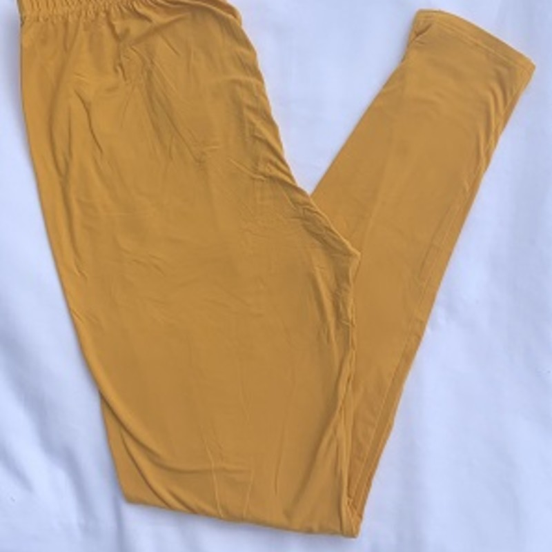 "Ladies we have all the leggings you need to get your fall wardrobe started. These are our wonderful buttersoft leggings with an elastic waist. 92 % Polyester 8% Spandex. Inseam 28""<br /> Mustard"