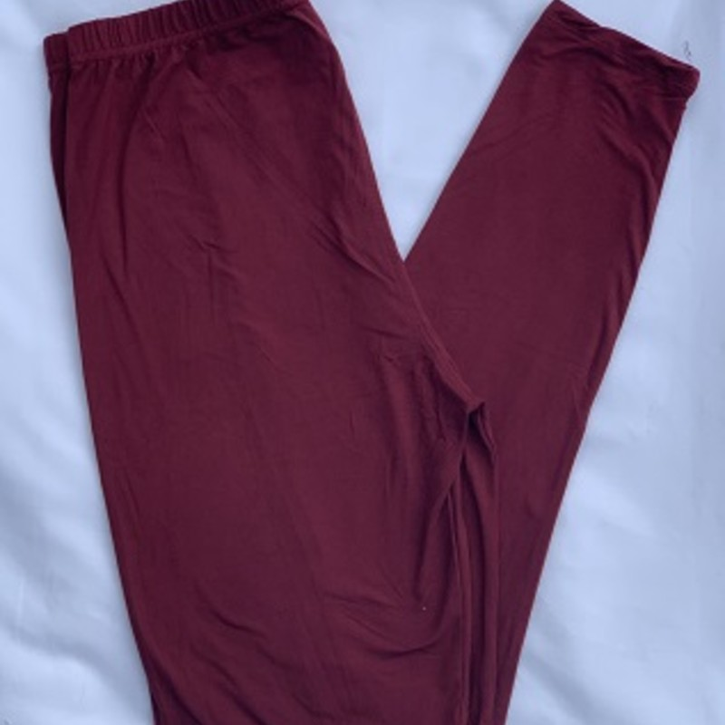 "Ladies we have all the leggings you need to get your fall wardrobe started. These are our wonderful buttersoft leggings with an elastic waist. 92 % Polyester 8% Spandex. Inseam 28""<br /> Burgundy"