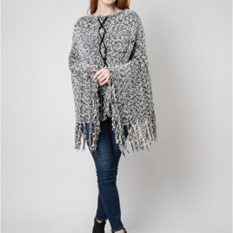 "Beth looks amazing in this Simply Noelle Poncho. It is the perfect item to get your fall wardrobe started. It will go perfect over your favorite outfit. Criss-Cross Grommet Details, Wear Many Ways, Wear Grommets Along Shoulder, Front or Back. 34""l x 34""W. Fringe: 7""L.  61% Polyester, 39% Acrylic. 25.5"""