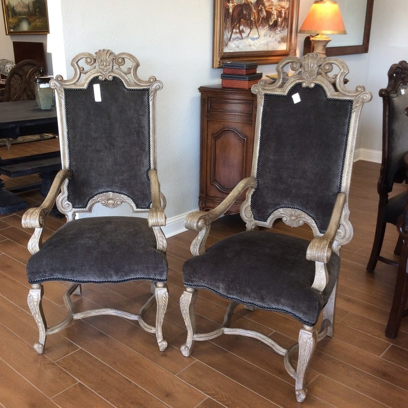 This is a beautiful pair of armchairs. Baroque in style, they are quite the statement pieces! Upholstered in a soft slate gray with a black nailhead trim. Really lovely!