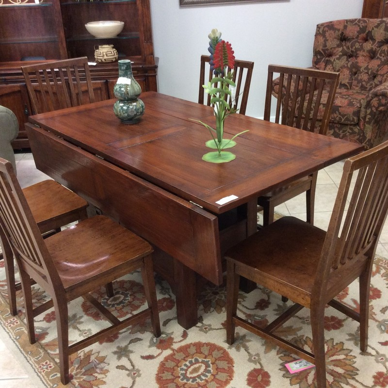 "This is a FABULOUS, solid wood table! When the leaves are down, it is only 25"" wide, but when they are up, it measures 44.5"" wide! The table base has 2 lower drawers that open from either side. The 6 chairs are also solid wood."