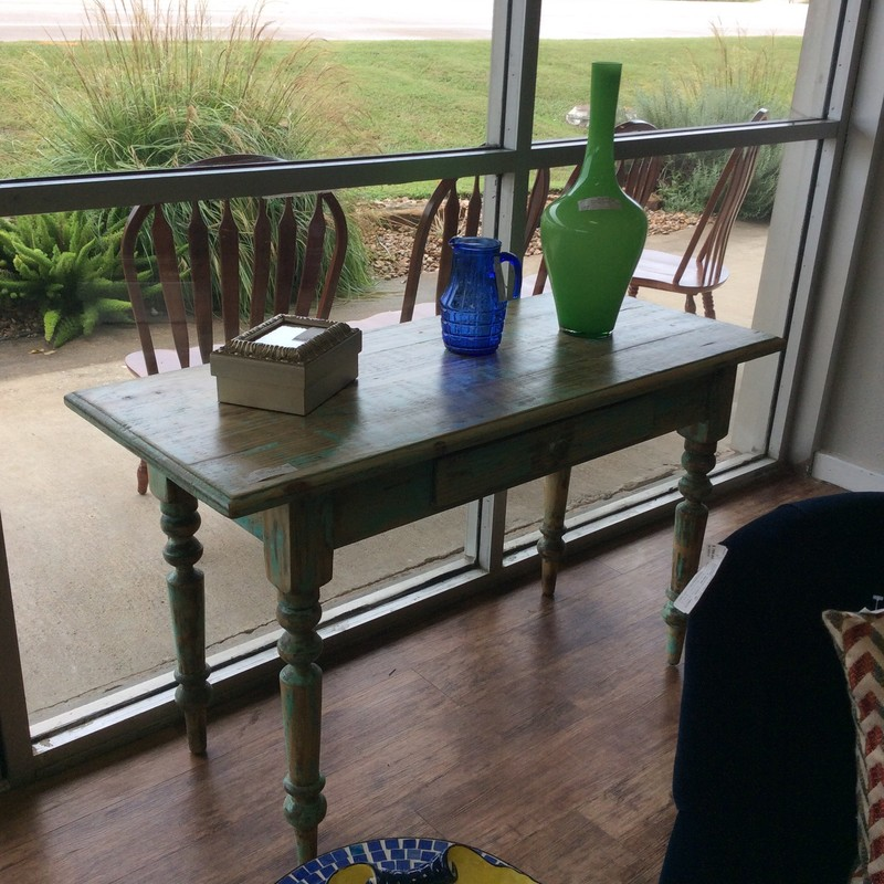 Oh-so-shabby!  This custom made writing desk is perfect for a smaller space. It's constructed of pine, painted an eye-catching sea green and distressed. It features a single drawer with dovetail jointing and turned legs. Lots of personality!