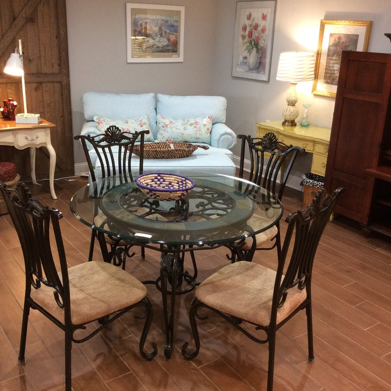 "This is a great set! Round at 48"", the glass top is supported by a heavy metal base that has been painted and bronzed and includes a slate inlay. Four upholstered chairs are included."