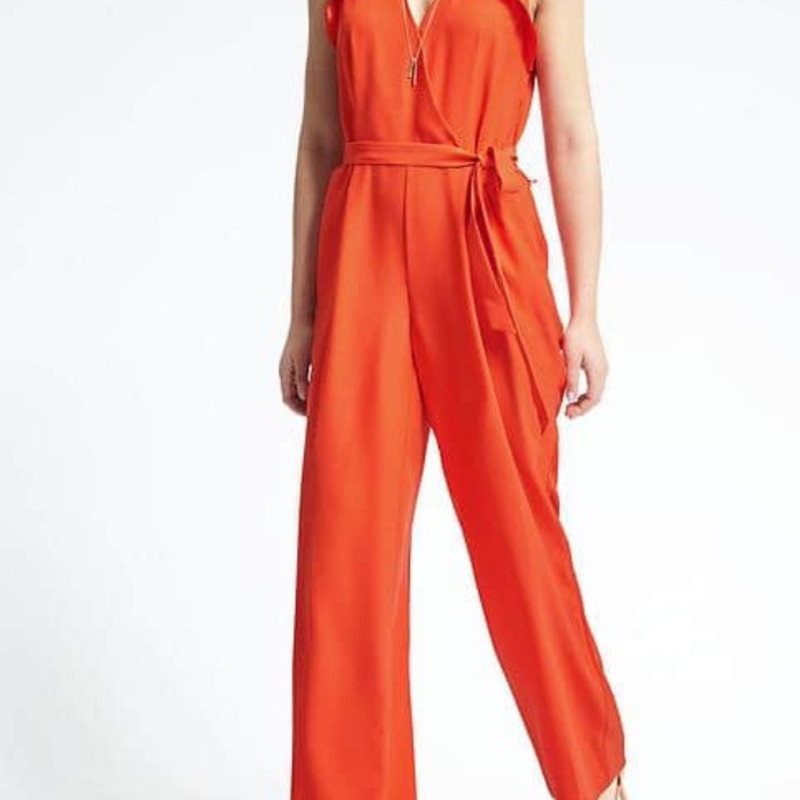 Banana Republic Orange Wide Leg Jumpsuit NWT orig. rtl: $ 140 size 6<br /> <br /> A sleeveless glam jumpsuit with tie front in a gorgeous orange color. Wide leg cut with v neck. Zips up the side