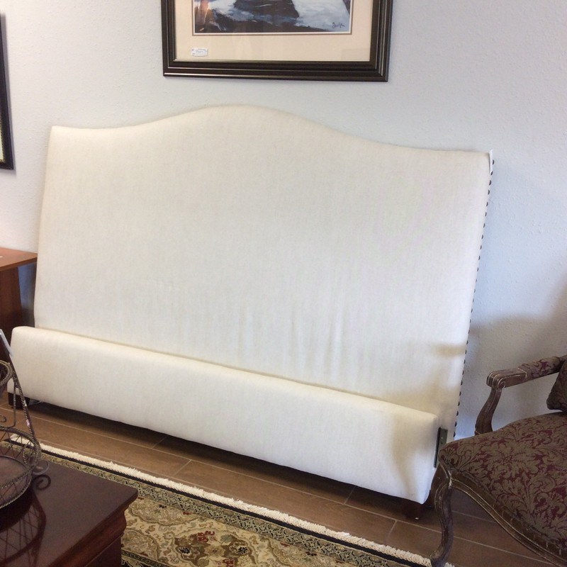 Beautiful bed by Pottery Barn! It includes a headboard, a footboard and rails. It has been upholstered in an oatmeal linen with a bold, large nailhead trim. Great  condition!